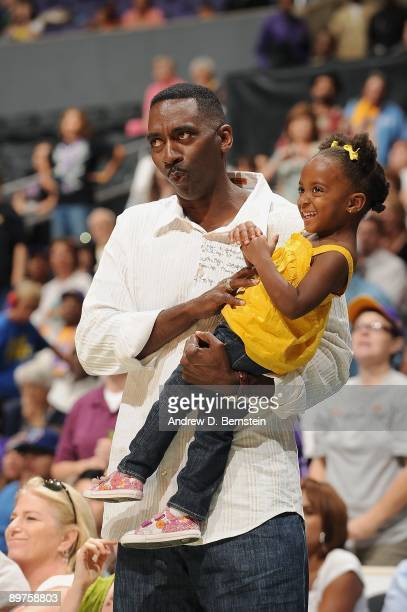 Lisa Leslie's daughter Lauren and Husband Michael Lockwood take in the WNBA game between the Seattle Storm and the Los Angeles Sparks on August 6...