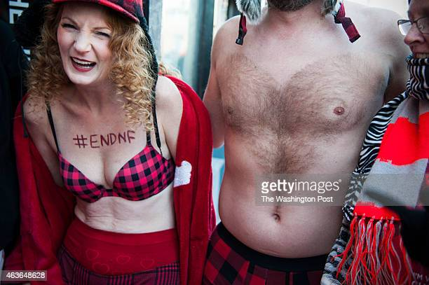 Lisa Levinski and Josh Suchy, who shaved a heart into his chest hair try to stay warm before the Cupid's Undie Run February 2015 in Washington, DC.