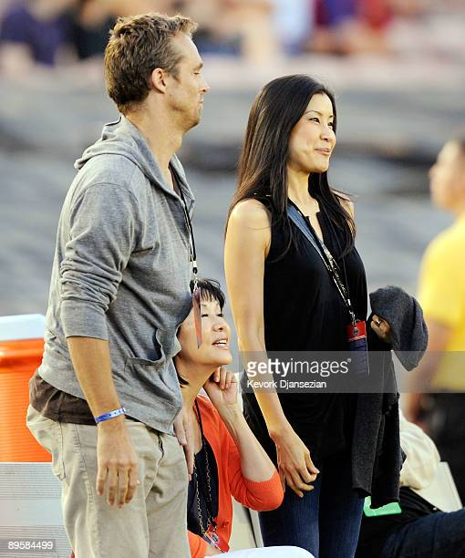 Lisa Ling the sister of imprisoned journalist Laura Ling mother Mary Ling and Lain Clayton, Laura Ling's husband look on prior to the start of the...