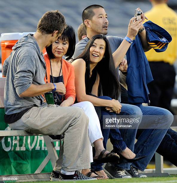 Lisa Ling the sister of imprisoned journalist Laura Ling, mother Mary Ling and Lain Clayton, Laura Ling's husband look on prior to the start of the...