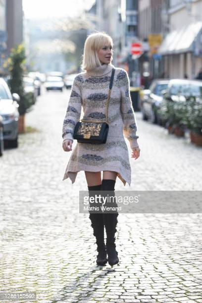 Lisa Loch is seen wearing Chanel knit dress with the colors beige, gray, nude, Chanel Boy handbag in leader with the color black and gold pattern and...