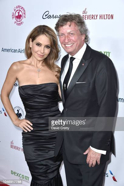 Lisa LoCicero and Nigel Lythgoe attend the 2018 Carousel Of Hope Ball at The Beverly Hilton Hotel on October 6 2018 in Beverly Hills California