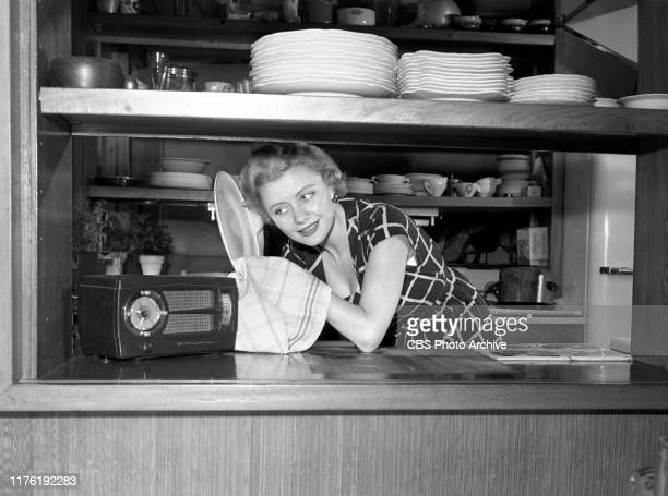 Lisa Loughlin CBS Radio actress and performer on the crime drama FBI in Peace and War She relaxes with radio at home May 28 1952