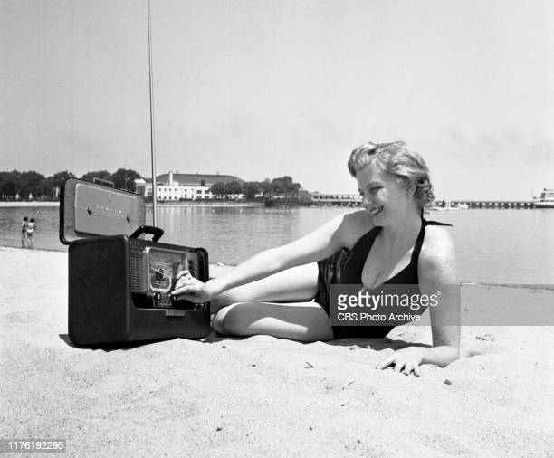 Lisa Loughlin CBS Radio actress and performer on the crime drama FBI in Peace and War She relaxes with radio at beach at Rye Playland May 28 1952