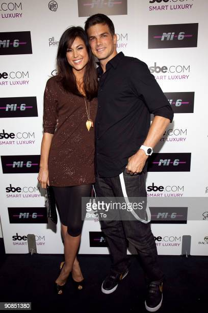 Lisa Mae and Rick Malambri attend Mi6 Nightclub Grand Opening Party on September 15 2009 in West Hollywood California