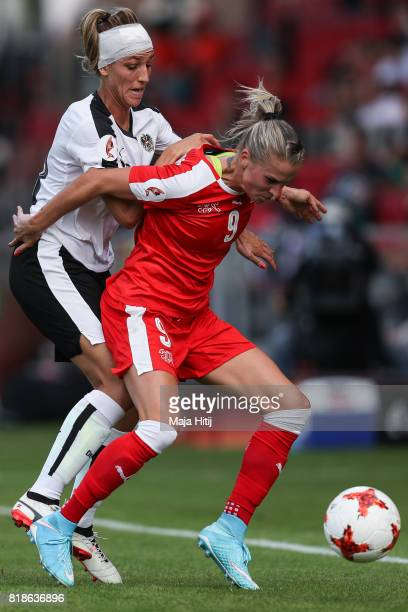 Lisa Makas of Austria and AnaMaria Crnogorcevic of Switzerland battle for the ball during the Group C match between Austria and Switzerland during...