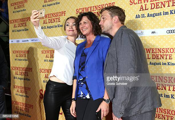 Lisa Maria Potthoff, Ilse Aigner and Sebastian Bezzel taking a selfie during the premiere of the film 'Schweinskopf al dente' at Mathaeser Filmpalast...