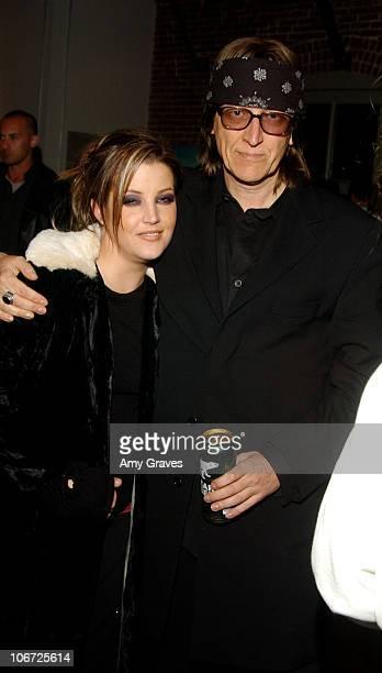 Lisa Marie Presley and Gottfried Helnwein during Vivid America Photo Exhibit by Meeno Hosted By Jason Lee at Jason Lee Studio Loft in Los Angeles...