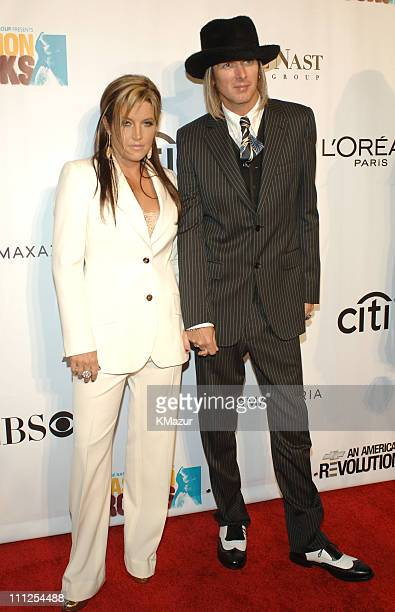 Lisa Marie Presley and guest during 2005 Fashion Rocks Red Carpet at Radio City Music Hall in New York City New York United States