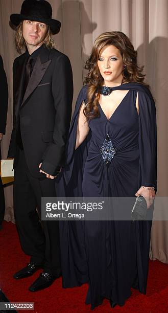 Lisa Marie Presley and guest during 2005 Glamour/Miramax Golden Globes PartyArrivals at Trader Vic's in Beverly Hills CA United States