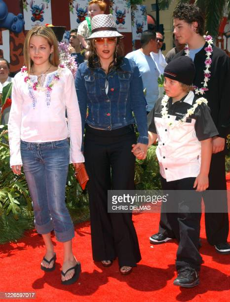 Lisa Marie Presley and her children Benjamin Keough Riley Keough and her halfbrother Navarone Garibaldi attend the premiere of Lilo and Stitch at the...