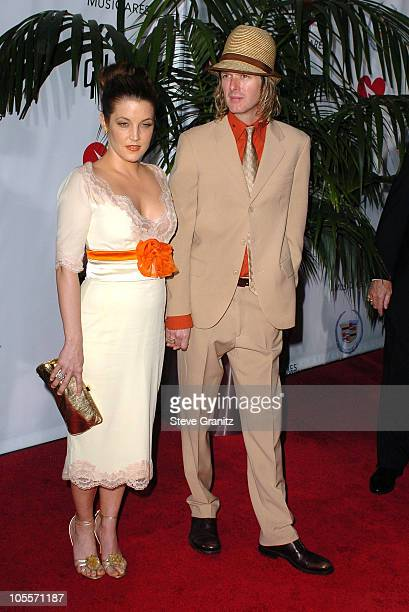 Lisa Marie Presley and Michael Lockwood during 2005 MusiCares Person Of The Year Brian Wilson Arrivals at Palladium in Hollywood California United...