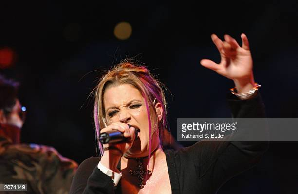 Lisa Marie Presley performs during half time of Game one of the 2003 NBA Finals between the San Antonio Spurs and the New Jersey Nets at the SBC...