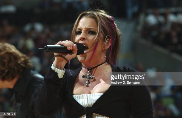 Lisa Marie Presley performs during halftime intermission of Game one of the 2003 NBA Finals between the New Jersey Nets and the San Antonio Spurs at...