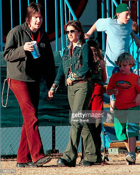 Lisa Marie Presley spends an afternoon with her fiance musician John Oszajca and her children Danielle and Benjamin at a carnival October 2000 in...