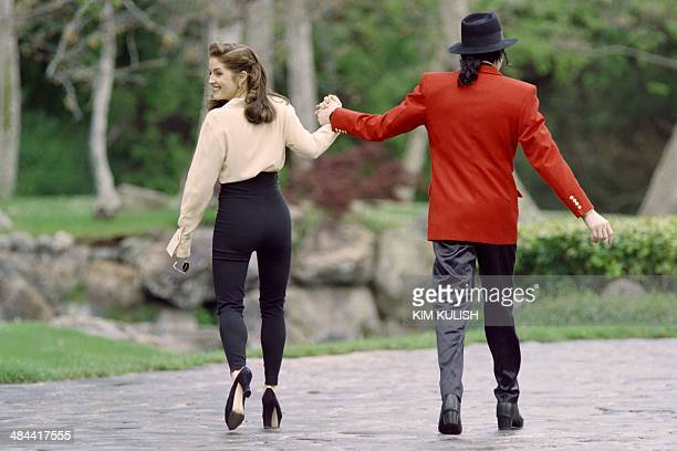 Lisa Marie Presley the daughter of rock legend Elvis Presley looks back on April 18 while walking with her husband Michael Jackson as they go to...