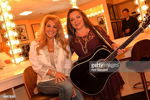 Lisa Matassa and Carlene Carter attend the Johnny Cash LimitedEdition Forever Stamp launch at Ryman Auditorium on June 5 2013 in Nashville Tennessee