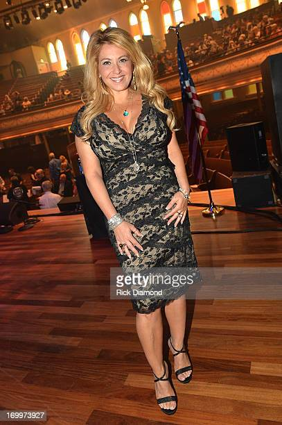 Lisa Matassa attends the Johnny Cash LimitedEdition Forever Stamp launch at Ryman Auditorium on June 5 2013 in Nashville Tennessee