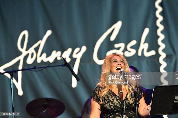Lisa Matassa performs at the Johnny Cash LimitedEdition Forever Stamp launch at Ryman Auditorium on June 5 2013 in Nashville Tennessee