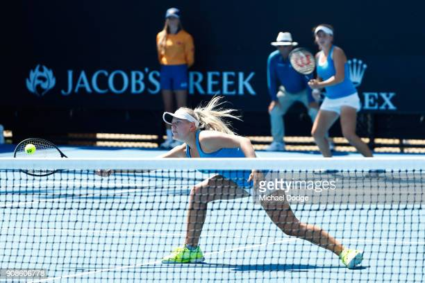 Lisa Mays of Australia and Amber Marshall of Australia compete in their girl's doubles match against Sohyun Park of Korea and Mananchaya Sawangkaew...