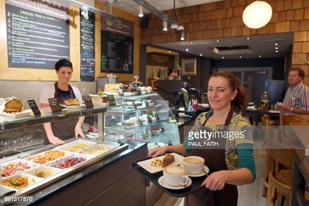 Lisa McAloon at work in the Cafe gift shop The Happiness Trap in Enniskillen town centre in County Fermanagh on May 30 2017 Last years Brexit...
