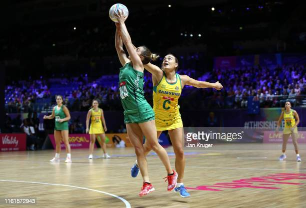 Lisa McCaffrey of Northern Ireland battles with Liz Watson of Australia during the preliminaries stage one match between Australia and Northern...