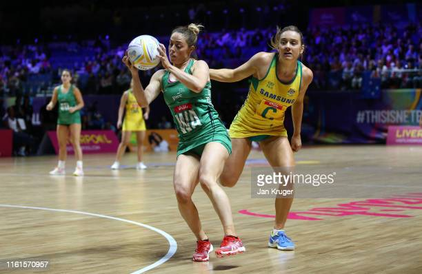 Lisa McCaffrey of of Northern Ireland battles with Liz Watson of Australia during the preliminaries stage one match between Australia and Northern...