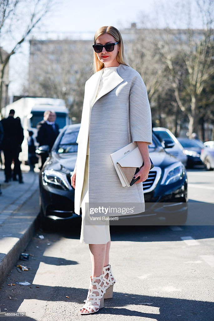 Lisa McComb poses wearing a Celine coat and clutch and Maiyet shoes on Day 6 of Paris Fashion Week Womenswear FW15 on March 8, 2015 in Paris, France.