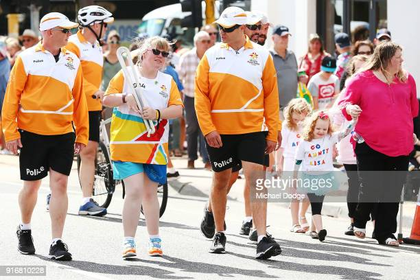 Lisa McLeish who was told at the age of 4 she would never walk again due to illness carries the Queens Baton during the Queens Baton Commonwealth...