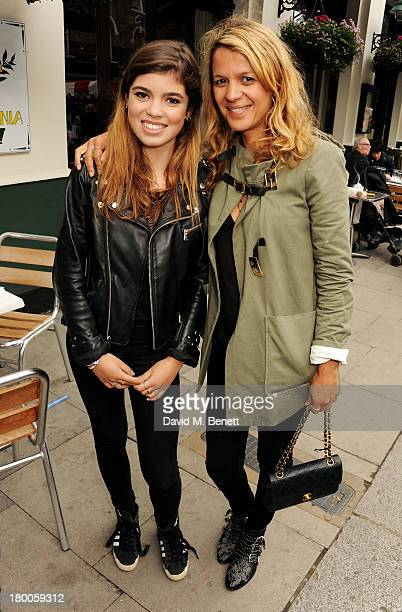 Lisa Moorish and daughter Molly Gallagher attend the Primrose Hill Festival on September 8 2013 in London England