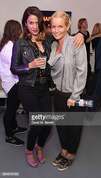 Lisa Moorish and Davinia Taylor attend a private view of 'Art Electric' a collaboration between artists Zoe Grace and John Morrissey at Lawrence...