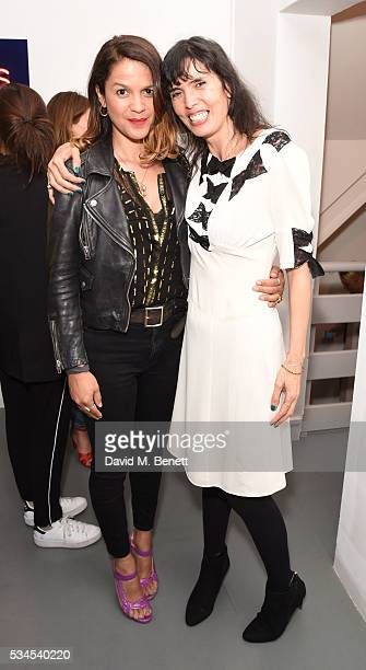 LIsa Moorish and Zoe Grace attend a private view of 'Art Electric' a collaboration between artists Zoe Grace and John Morrissey at Lawrence Alkin...