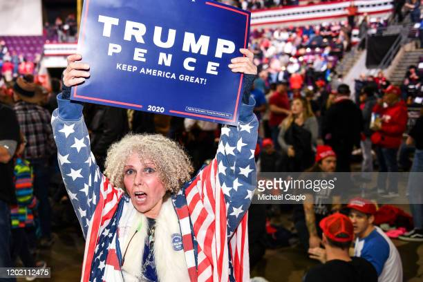 Lisa Neifert cheers as she awaits the arrival of President Donald Trump at a Keep America Great rally on February 20, 2020 in Colorado Springs,...