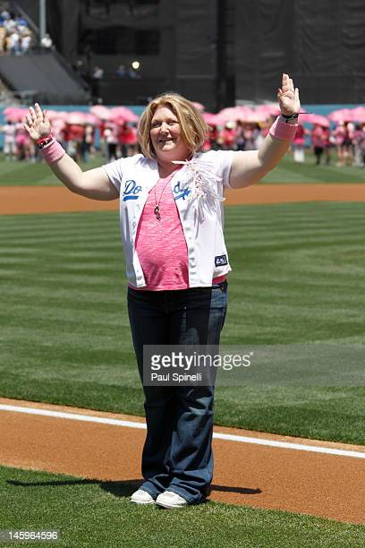 Lisa NevoloLewis waves to the crowd while being announced as a cancer survivor and the honorary bat girl of the day during the Los Angeles Dodgers...