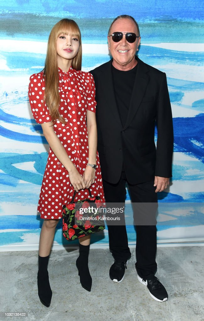 Lisa of Blackpink (L) and Michael Kors pose backstage during the Michael Kors Collection Spring 2019 Runway Show at Pier 17 on September 12, 2018 in New York City.