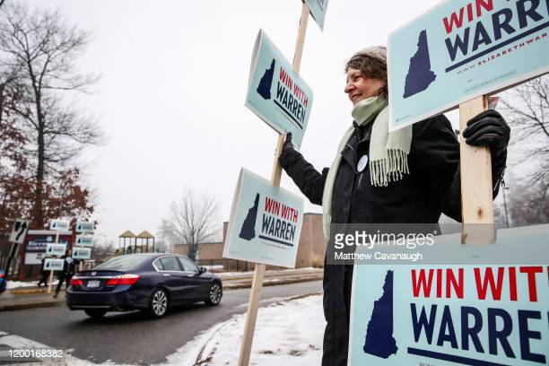 Lisa Olney of Wellesley MA holds signs in support of Democratic presidential candidate Sen Elizabeth Warren outside of a polling place during the New...