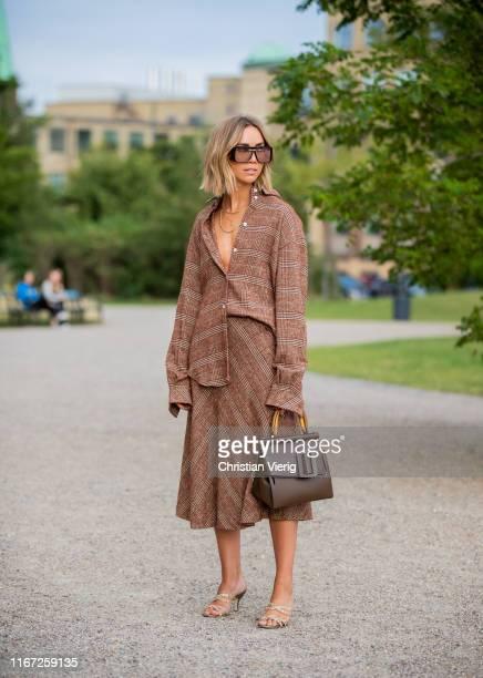 Lisa Olsson is seen wearing brown skirt and button shirt bag outside Samsøe Samsøe during Copenhagen Fashion Week Spring/Summer 2020 on August 07...