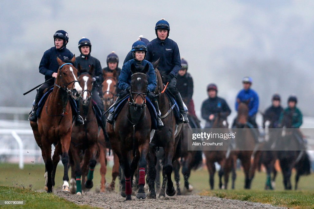 Lisa O'Neill riding Apple's Jade (C) lead the Gordon Elliott string around the gallops at Cheltenham racecourse on March 12, 2018 in Cheltenham, England.