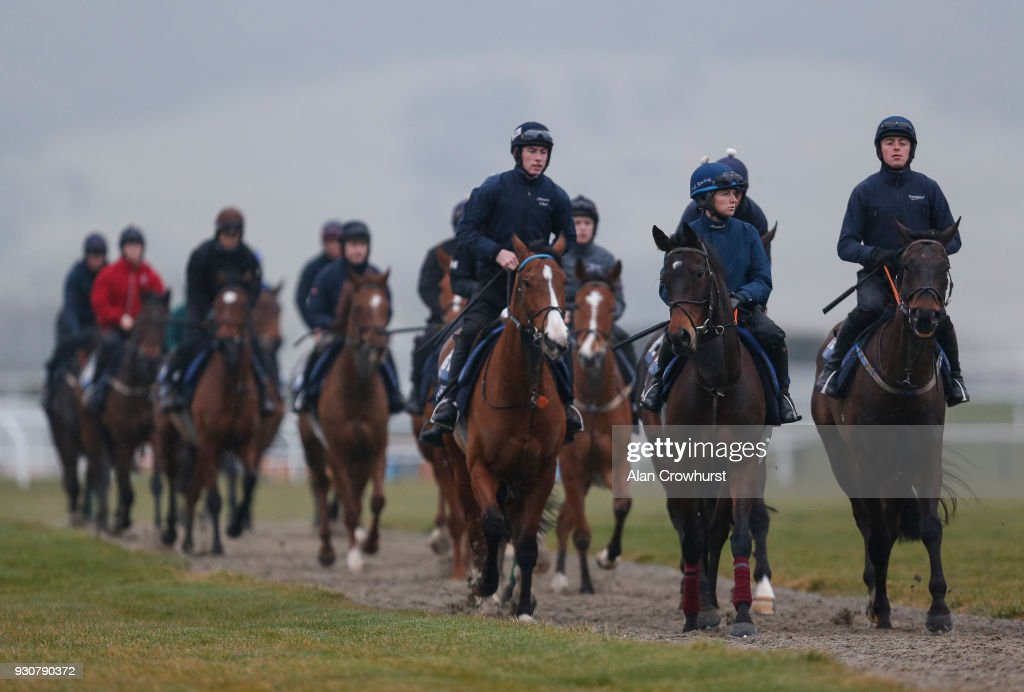 Lisa O'Neill riding Apple's Jade (2R) on the gallops at Cheltenham racecourse on March 12, 2018 in Cheltenham, England.
