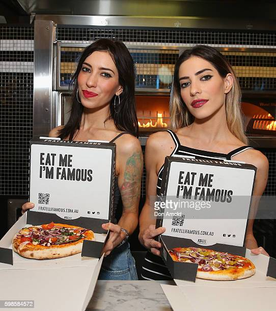 Lisa Origliasso and Jess Origliasso from The Veronicas pose with pizzas they had made during the launch of Fratelli Famous at Westfield Sydney on...