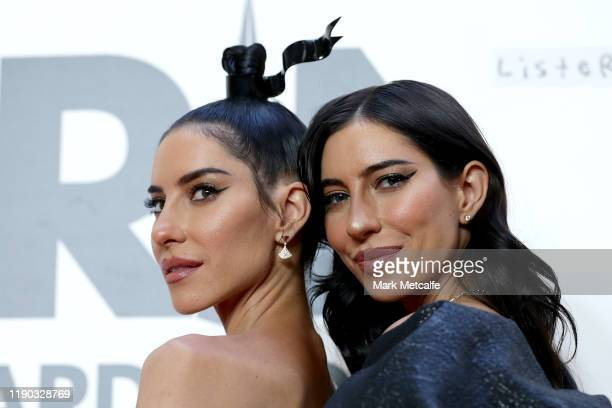 Lisa Origliasso and Jessica Origliasso of The Veronicas arrive for the 33rd Annual ARIA Awards 2019 at The Star on November 27 2019 in Sydney...