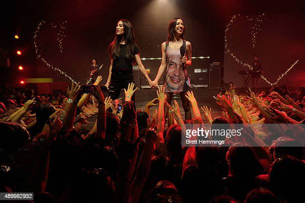 Lisa Origliasso and Jessica Origliasso of The Veronicas performs during the Nickelodeon Slimefest 2015 evening show at Sydney Olympic Park Sports...