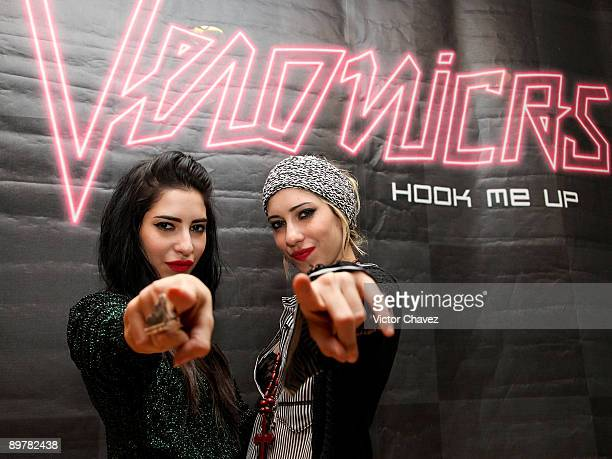Lisa Origliasso and Jessica Origliasso of The Veronicas pose for photographs during their showcase and autograph signing at MixUp Plaza Loreto on...