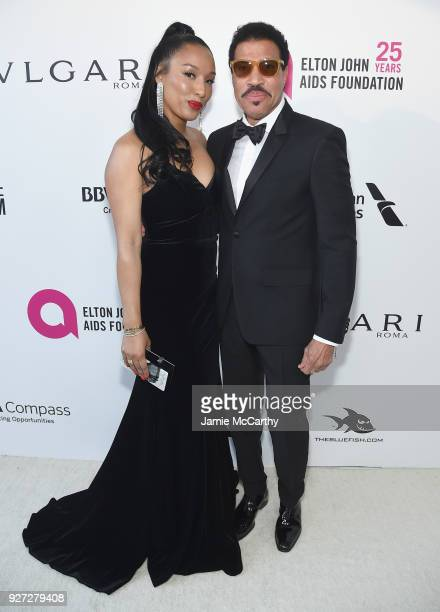 Lisa Parigi and Lionel Richie attend the 26th annual Elton John AIDS Foundation Academy Awards Viewing Party sponsored by Bulgari, celebrating EJAF...