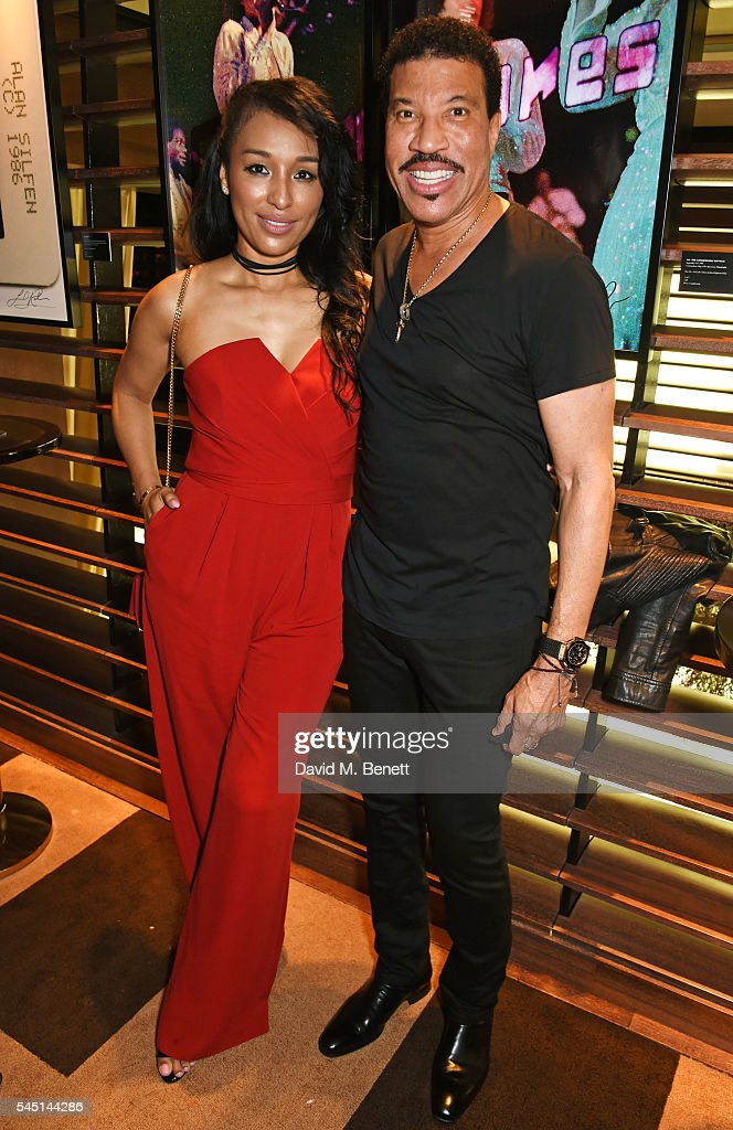 Lisa Parigi (L) and Lionel Richie attend the exclusive Lionel Richie exhibition 'STILL' by US photographer Alan Silfen at Dorchester Collections Mayfair hotel, 45 Park Lane, on July 5, 2016 in London, England.