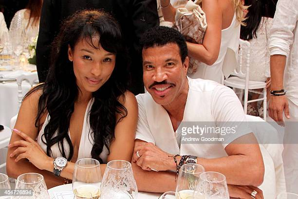 Lisa Parigi and Lionel Richie attend the White Party Dinner Hosted by Andrea and Veronica Bocelli Celebrating Celebrity Fight Night In Italy...