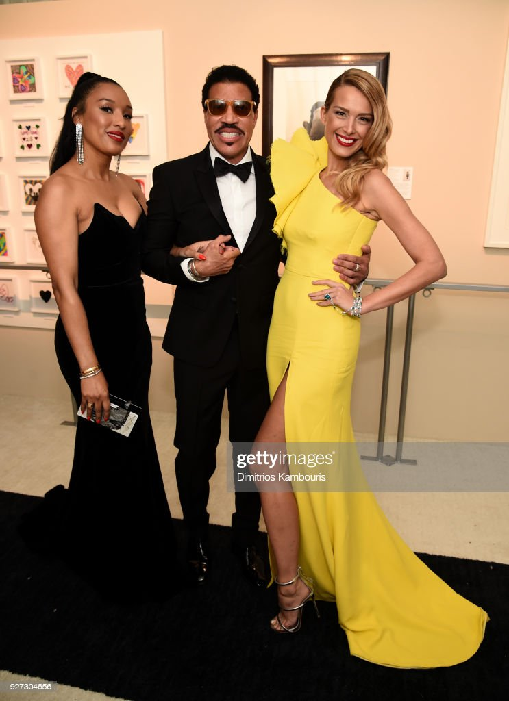 Lisa Parigi, Lionel Richie, and Petra Nemcova attends the 26th annual Elton John AIDS Foundation Academy Awards Viewing Party sponsored by Bulgari, celebrating EJAF and the 90th Academy Awards at The City of West Hollywood Park on March 4, 2018 in West Hollywood, California.
