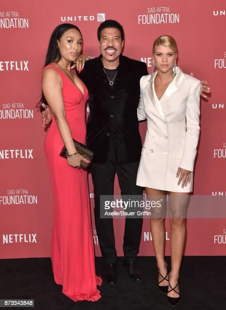 Lisa Parigi singer Lionel Richie and daughter Sofia Richie arrive at SAGAFTRA Foundation Patron of the Artists Awards 2017 on November 9 2017 in...