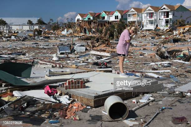 Lisa Patrick is overcome with emotion as she visits the remains of her home to see if she can salvage anything after it was destroyed by Hurricane...