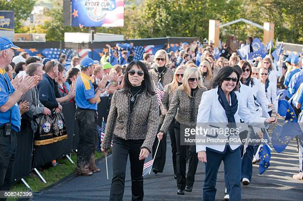 Lisa Pavin and Gaynor Montgomerie walk toward the stage during the Closing Ceremonies at the 38th Ryder Cup at the Twenty Ten Course at Celtic Manor...